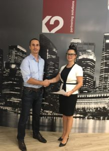 K2's Ludovic Frichment and Responsible Cyber's Magda Chelly sign strategic alliance.